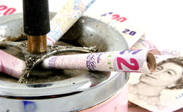 Smoking money Royalty Free Stock Photo