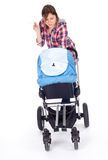 Smoking mother with baby stroller Stock Image