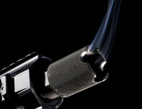 Smoking muzzle. Business end of a gun with smoke rising on a black background Stock Photo