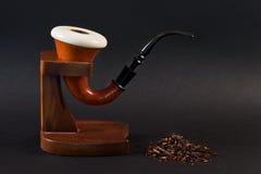 Smoking pipe. Sherlock Holmes smoking pine with stand and tobacco Stock Image