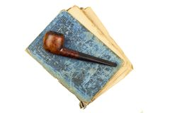 Smoking pipe and antique books. Tobacco pipe on ancient books. Relax by reading old books. Smoking. Royalty Free Stock Photography
