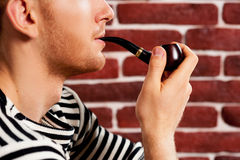 Smoking a pipe. Stock Image