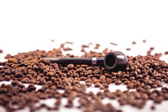 Smoking pipe. On a coffee beans Stock Images