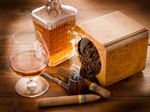 Smoking pipe  cuban cigar Stock Images