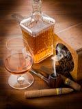 Smoking pipe  cuban cigar and liquor. Smoking pipe, tobacco, cuban cigar and liquor Royalty Free Stock Image