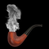 Smoking pipe with gray smoke on the black background.  Royalty Free Stock Photography