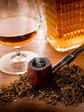 Smoking pipe and liquor Royalty Free Stock Photo