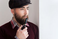 Smoking a pipe. Stock Photography