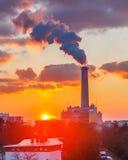 Smoking pipe at sunset Royalty Free Stock Photo