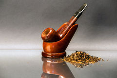 Smoking pipe. A smoking pipe in a support with some pipe tobacco Stock Photography