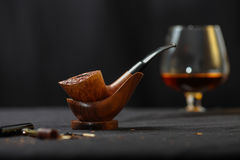 Smoking pipe. On the table Stock Image