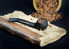 Smoking pipe and tobacco Stock Photos