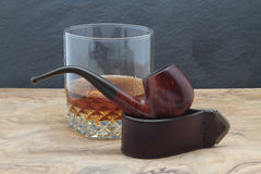 Smoking pipe and whisky Royalty Free Stock Photo