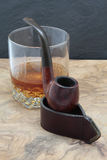 Smoking pipe and whisky Royalty Free Stock Images