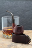 Smoking pipe and whisky Royalty Free Stock Photos