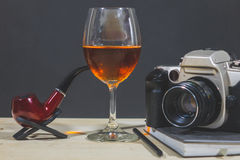 Smoking pipe and Wild Red. With Camera on Book royalty free stock photos