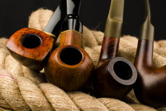 Smoking pipes. Variation of smoking pipes on the rope Stock Photography