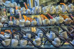 Smoking pipes with carving on the Grand Bazaar royalty free stock photography