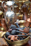 Smoking pipes and copper jugs Royalty Free Stock Photos