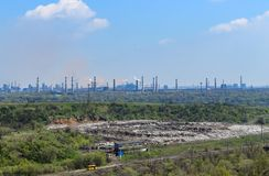 The smoking pipes of the factories behind the landfill. Kryvyi Rih stock images