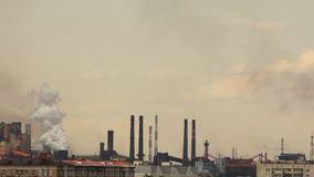 City landscape with smoking metallurgical chimneys. stock video footage
