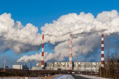 Smoking pipes of a power plant on a winter day in Siberia stock photography