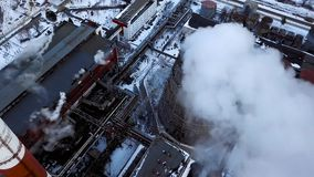 Smoking pipes of thermal power plant. Aerial view. Pipes of thermal power plant. heating season. Smoking pipes of thermal power plant. Aerial view. Pipes of stock video