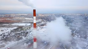 Smoking pipes of thermal power plant. Aerial view. Pipes of thermal power plant. heating season. Smoking pipes of thermal power plant. Aerial view. Pipes of stock video footage