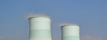 Smoking pipes of thermal power plant with cleared sky. Stock Photo