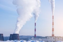 Smoking pipes of thermal power plant emitting carbon dioxide in the atmosphere. Concept of environmental pollution. Smoking pipes of thermal power plant emitting Royalty Free Stock Image