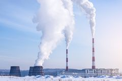 Smoking pipes of thermal power plant emitting carbon dioxide in the atmosphere. Concept of environmental pollution. Smoking pipes of thermal power plant emitting Stock Images