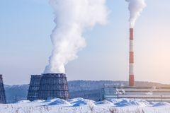 Smoking pipes of thermal power plant emitting carbon dioxide in the atmosphere. Concept of environmental pollution. Smoking pipes of thermal power plant emitting Stock Photo