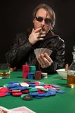 Smoking poker player wearing sunglasses Royalty Free Stock Photo