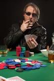 Smoking poker player wearing sunglasses Royalty Free Stock Photo