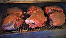 Smoking Pork Shoulders on a Traeger Pellet Smoker. For pulled-pork BBQ Stock Photo