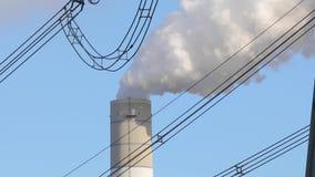 Smoking power plant. Chimney closeup stock video footage
