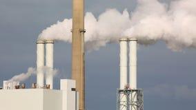 Smoking power plant. Chimney closeup stock footage