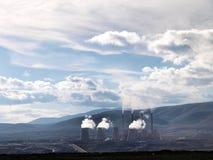 Smoking power station chimneys. View of smoking chimneys of power station polluting atmosphere royalty free stock photo