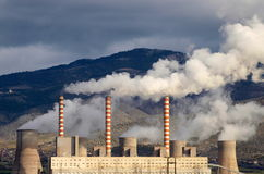 Smoking power station chimneys Stock Photo