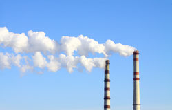 Smoking power station chimneys Royalty Free Stock Image