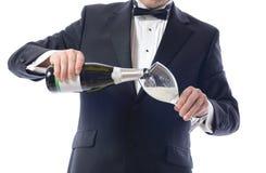 Smoking que derrama Champagne Imagem de Stock