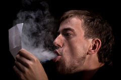 Smoking and rading Stock Photos