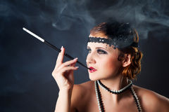 Smoking retro-styled sexy lady Stock Image