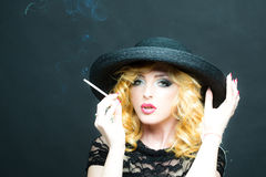 Smoking retro woman Royalty Free Stock Photo