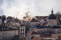 Smoking roof in Dubrovnik old town detail with churchtower, Croatia Royalty Free Stock Image