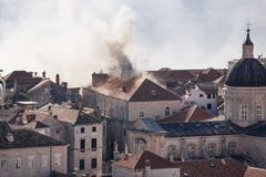 Smoking roof in Dubrovnik old town detail with churchtower, Croatia Royalty Free Stock Photos