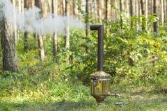Smoking russian samovar. On woods background Royalty Free Stock Image