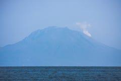 Smoking Sakurajima volcano near Royalty Free Stock Images