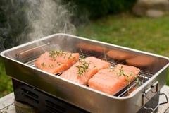 Smoking the salmon Stock Photos