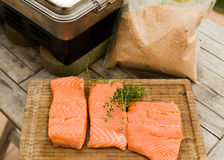Smoking the salmon. Salmon and sawdust for smoking on the table outdoors Stock Photo